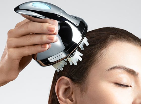 ReFa Head and Scalp Massager in Use